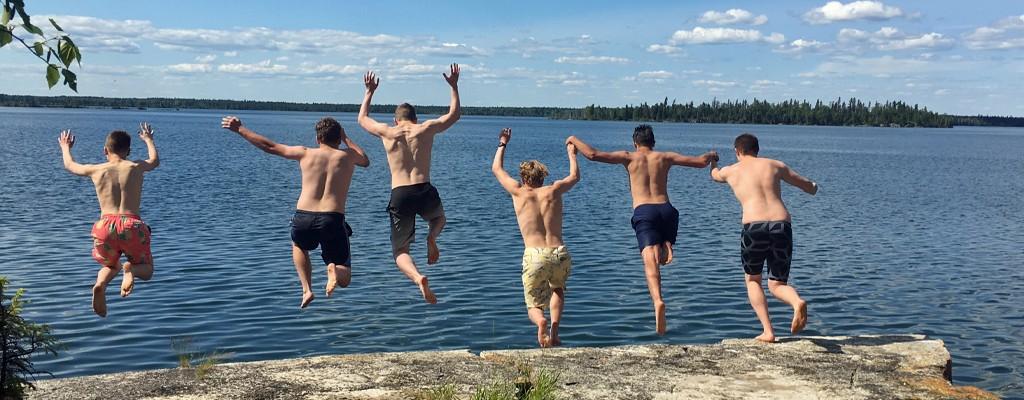 northern Manitoba summer camp staff cliff jumping